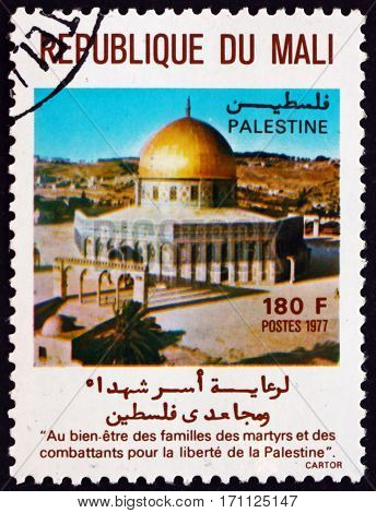 MALI - CIRCA 1977: a stamp printed in Mali shows Dome of the Rock is an Islamic shrine located on the Temple Mount Jerusalem circa 1977