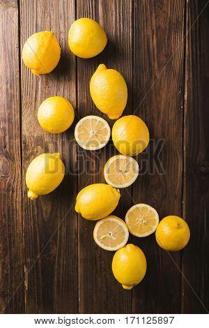 Lemons on a wooden background. Lemons. Fruits. Lemon halves. Mint. Healthy food concept. Copyspace