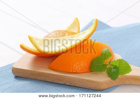 pile of orange peels on wooden cutting board - close up