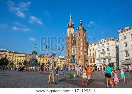 KRAKOW, POLAND - SEP 7, 2016: Main Market Square. Project for Public Spaces (PPS) lists the square as the best public space in Europe due to its lively street life. 13th century, at roughly 40,000 m2.