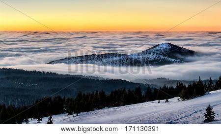 Mountain peak in the clouds at sunset, mountain Kopaonik, Serbia
