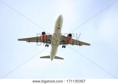 a midsize Commercial airplane approaching the runway