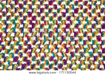 Colorful baby blanket crochet with bright festive yarn using granny square stitch in single rows on a white background to show spacing. Basic design very simple easy to make.