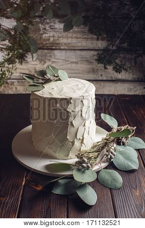 White Cream Cake Decorated With Green Leaves