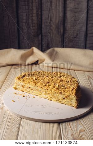 Beautiful Cut In Half Layered Napoleon Cake On Wooden Table
