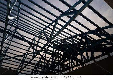 Silhouette background Structure of steel roof frame for building construction