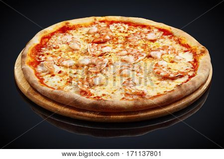 Pizza with tiger shrimp and cream cheese on a black background