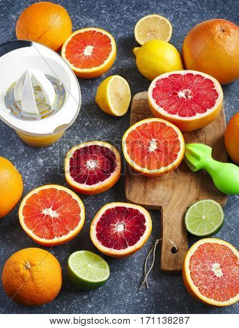 Citrus fruits on stone background top view