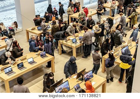 New York February 9 2017: People are browsing inside Apple store on 5th Avenue.
