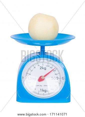 Chinese Pear On Kitchen Scale Isolated On White Background