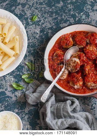 Turkey meatballs in tomato sauce and rigatoni pasta. Delicious lunch top view