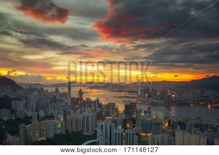 Cityscape of Hong kong and Kowloon with harbour and sunset big city in China