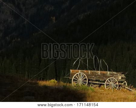 Old wooden wagon in sun with dark background