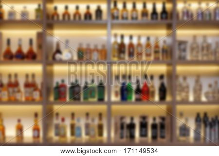 Various alcohol bottles in bar, intentional strong blur