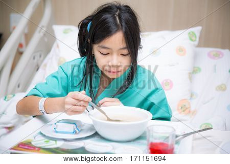 Woman patient in hospital bed from cold and eating food for patient person