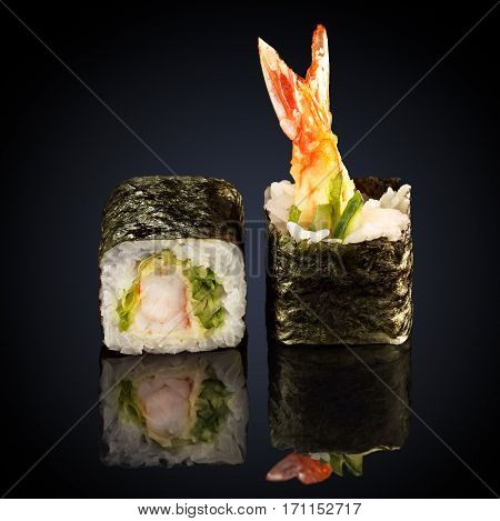 rolls with shrimp and cucumber on a black background