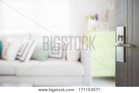 Opened Wooden Door To Cozy Sofa With Geometric Pattern Pillows And Green Sideboard In Living Corner
