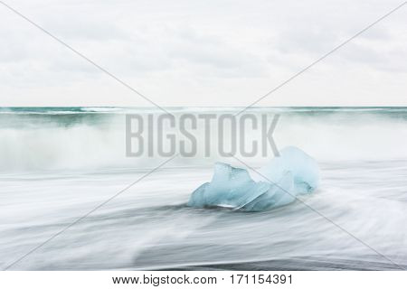 Iceberg piece on Diamond beach, near Jokulsarlon lagoon, Iceland.
