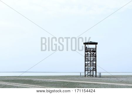 Alone observant tower and silhouette of man