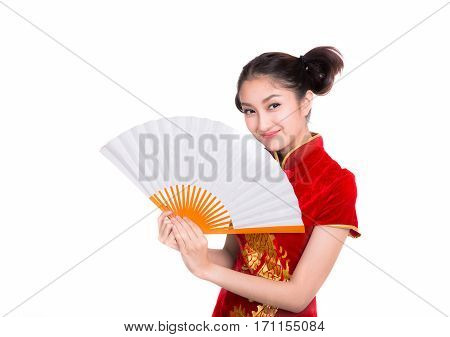 Beautiful Asian girl with Chinese traditional dress Cheongsam holding a Chinese Fan isolated on white background