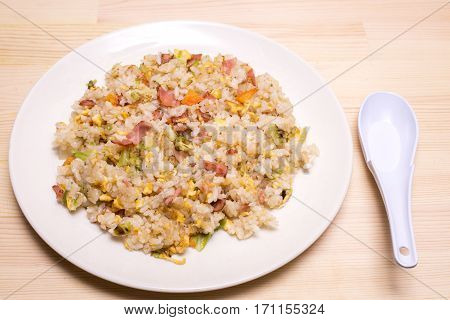Chinese fried rice on dish with china spoon