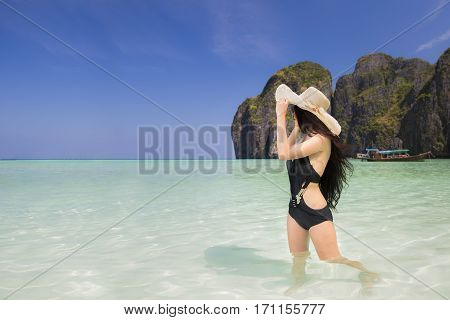 Portrait of woman in black swim posing on tropical beach maya beach Phi Phi island near Phuket in Thailand