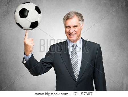 Man spinning a soccer ball on his finger