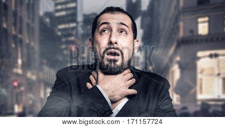 Man choking in a polluted city