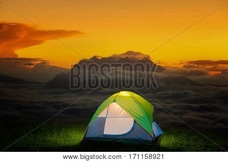 Morning sunrise over mist with Huai Nam Dang National Park Chiang Mai Thailand landscape travel and nature Small Camping Tent Illuminated Inside. Night Hours Campsite. Outdoor