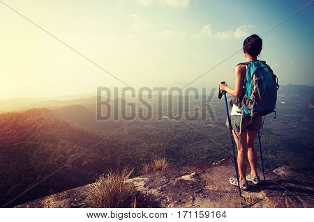 young woman hiker enjoy the view at mountain peak