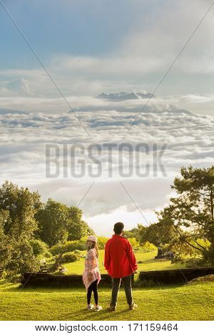 Morning sunrise over mist with tourist and photographer Huai Nam Dang National Park Chiang Mai Thailand landscape travel and nature concept