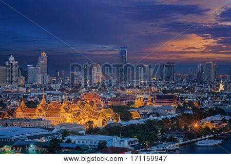 Grand palace and Wat phra keaw at sunset with bangkok city backgroung bangkok Thailand