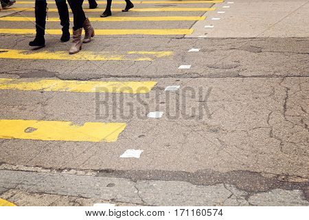 yellow crossroad with walking pedestrians toning copy space