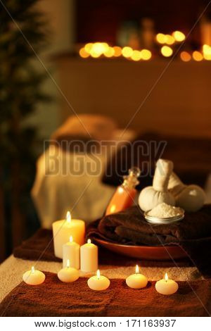 Natural treatments and alight candles in spa salon