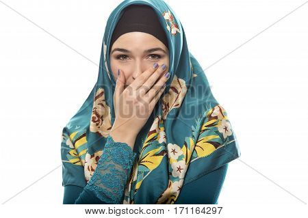 Female wearing a hijab conservative fashion for muslims middle east and eastern european culture. She is isolated on a white background and looking shy