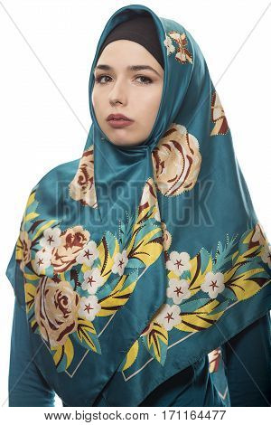 Female wearing a hijab conservative fashion for muslims middle east and eastern european culture. She is isolated on a white background and looking confident and strong