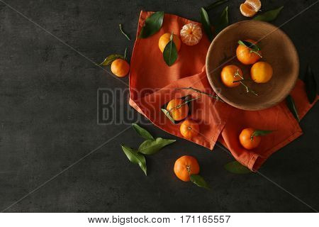 Juicy tangerines on color background