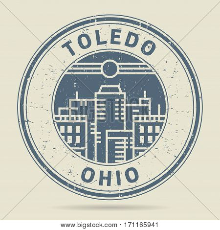 Grunge rubber stamp or label with text Toledo Ohio written inside vector illustration