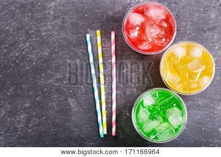 Colorful Cold Drinks In Plastic Cups