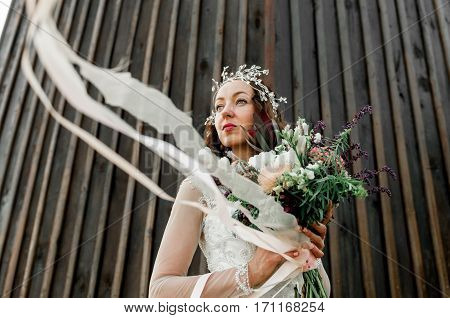 Bride With Beautiful Bouquet Of Green