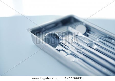 Tray with dentist equipment on table