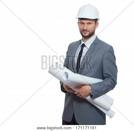 Side view of confident architect holding many drawing plans of buildings. Engineer  wearing in safety hat and gray suite  smiling at camera. Isolate on white background.