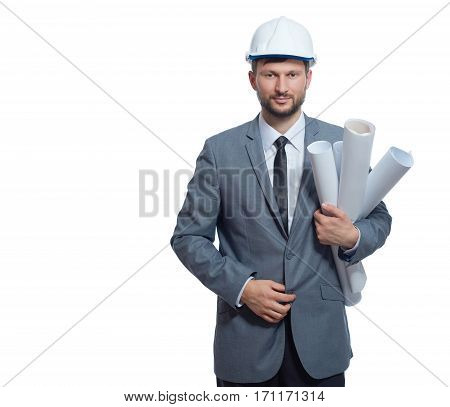 Front view of architect wearing in gray suite and white safety hat holding many paper drawing plans of buildings. Engineer looking and smiling at camera. Isolate on white.