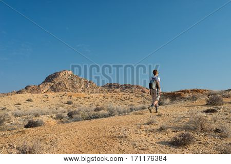 One Person Hiking In The Namib Desert, Namib Naukluft National Park, Namibia. Adventure And Explorat