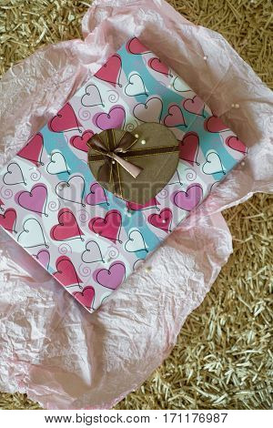 Valentines day gift set. A heart shape cute gift box placed on a large wrapped box.