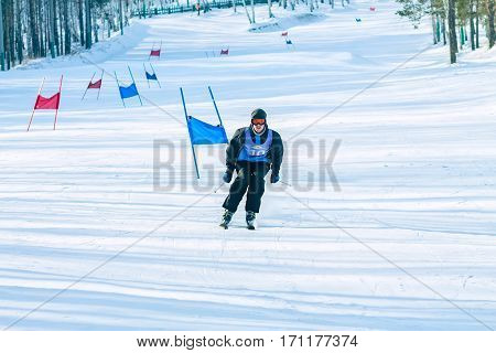 Irkutsk, Russia - February 12, 2017: Slalom competition snowboarding and skiing for adults and children in Irkutsk on the ski base in Akademgorodok Academy Cup in 2017