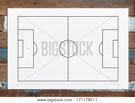 Abstract soccer field or football field background for create soccer tactic and writing a soccer game strategy. With white paper background on wood texture.