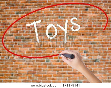 Woman Hand Writing Toys  With Black Marker On Visual Screen