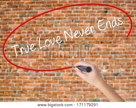 Woman Hand Writing True Love Never Ends With Black Marker On Visual Screen