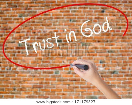 Woman Hand Writing Trust In God With Black Marker On Visual Screen